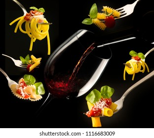 Glass of red wine and forks with various types of pasta isolated on black background