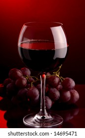 a glass of red wine grape