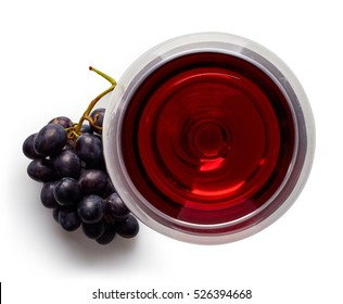 Glass of red wine and grapes isolated on white background from top view