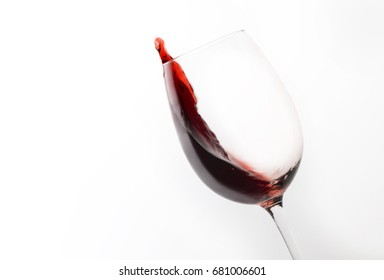 glass with red wine isolated on white background