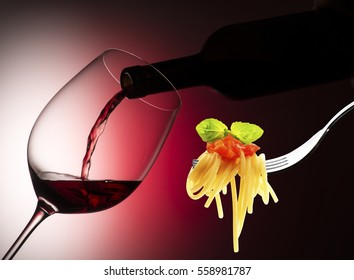 glass with red wine on the red background