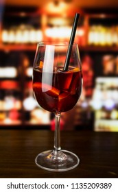Glass of red wine on bar
