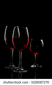 Glass with red wine on a black background