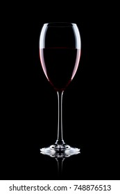 Glass of red wine on black background with reflection