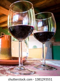 Glass of red wine on a table in rustic restaurant