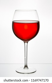 Glass of red wine in a glass on a white background