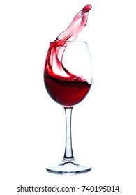 Glass of red wine on white background. Red wine splashing in a glass