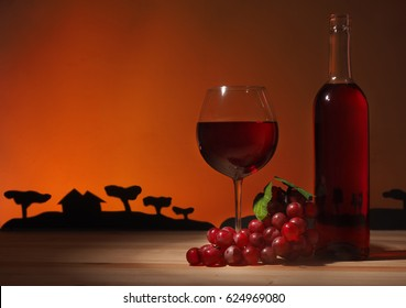 Glass of Red Wine on wooden background