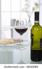 glass of red wine over  table