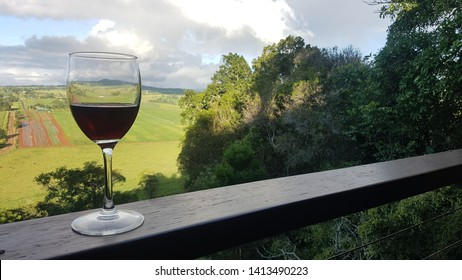 Glass of Red wine overlooking a valley