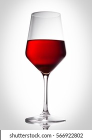 Glass of red wine with reflection on white background