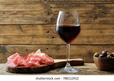 a glass of red wine rustic background