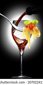 glass with red wine and spaghetti