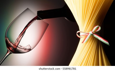 glass with red wine and spaghetti with italian flag