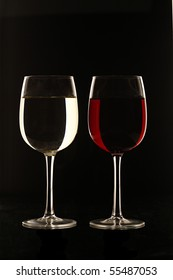Glass of Red Wine and White Wine against Black Background