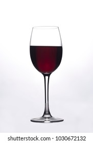 Glass of the red wine in white background