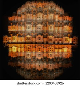 Glass reflection night view Hawa Mahal palace  in Jaipur, Rajasthan, India.