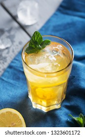 Glass of refreshing homemade lemonade with ice and mint. Vertical orientation