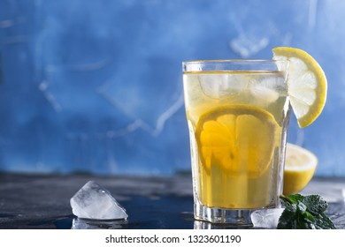 Glass of refreshing homemade lemonade with ice and mint. Horizontal orientation