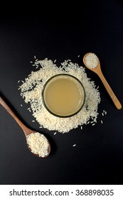 A glass of Rice Wine on black background