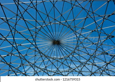 Glass roof of the building over blue sky