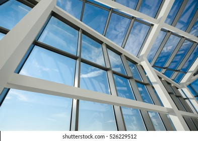 Glass roof construction against blue sky