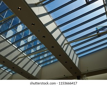 Glass roof of modern building with background of clear blue sky