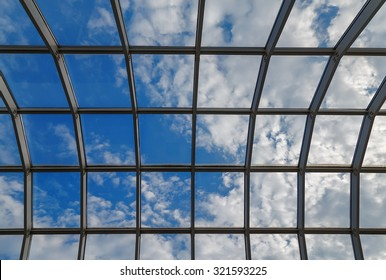 glass roof sky clouds