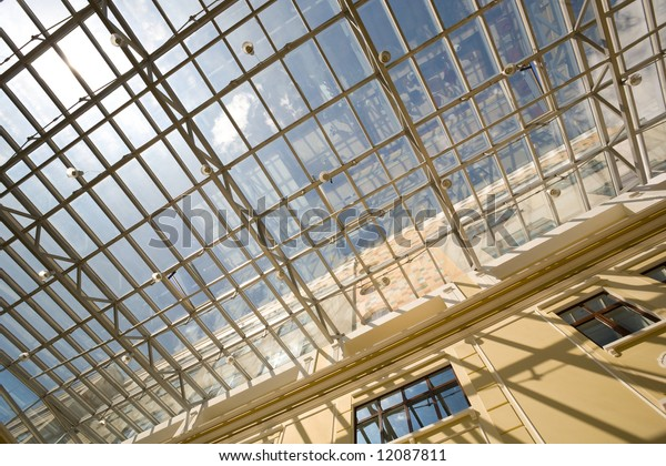 glass roof with sky reflection