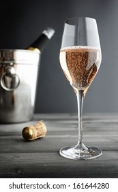 Glass of Rose / Pink Champagne and Cooler, selective focus