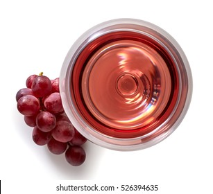 Glass of rose wine and grapes isolated on white background from top view