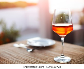 Glass of rose wine on table outdoor close-up