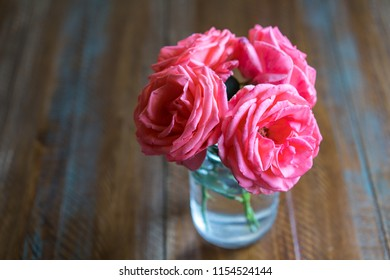 Glass of Roses on a Table