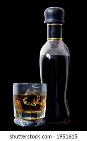 Glass of rum and bottle over black