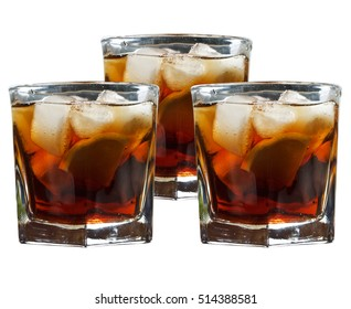 Glass of rum with ice isolated on white