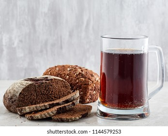 Glass of russian traditional drink kvass. Served with bread on light background