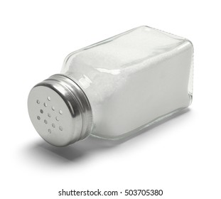 Glass Salt Shaker Tipped Over Isolated on White Background.