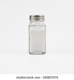 Glass salt shakers on white background