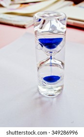 Glass sand watch hourglass on gray background