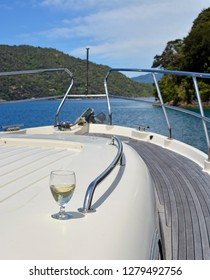 A Glass of Sauvignon Blanc Wine on the deck of a Luxury Motor Boat in the Marlborough Sounds New Zealand.