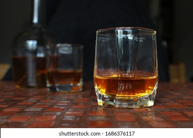 Glass of scotch whiskey or brendy on dark background