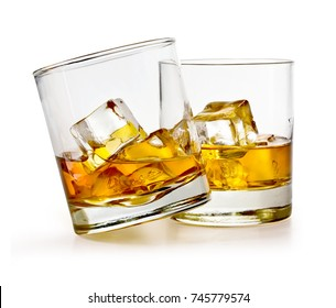 Glass of scotch whiskey and ice on a white background with clipping path