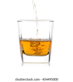 Glass of scotch whiskey  on a white background