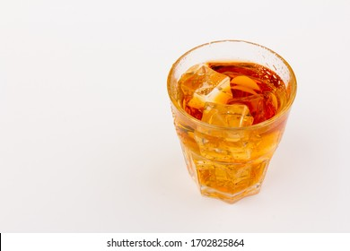 Glass of Scotch whisky with ice, isolated on  white background.Various alcoholic cocktails. Place for text