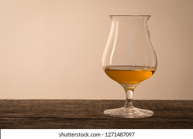 Glass of scottish single malt whisky on wood