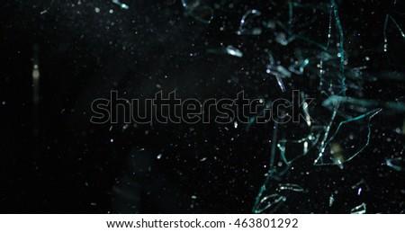Glass shards flying through