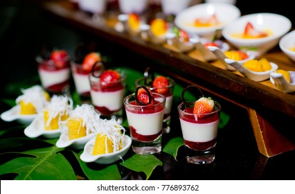 Glass shots  pastry. wedding catering food. mini canapes food.  tasty dessert. Beautiful decorate catering banquet table.  snacks and appetizers. wedding celebration