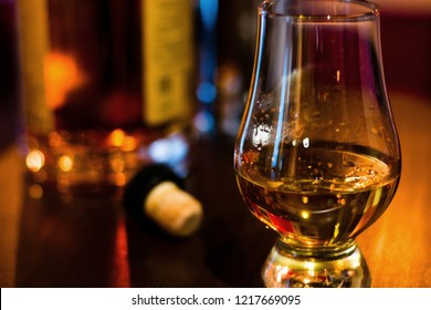 glass of single malt whiskey in the background of a bottle