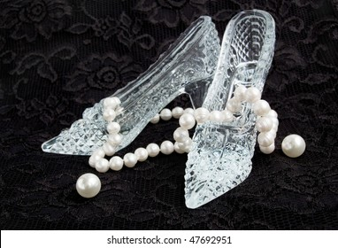 Glass slippers with pearls on a black lace