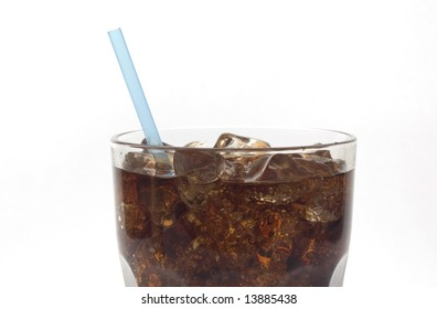 Glass of soda with a straw against white close-up of top